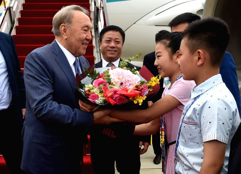 QINGDAO, June 9, 2018 - Kazakh President Nursultan Nazarbayev (1st L) is greeted upon his arrival in Qingdao, east China's Shandong Province, June 9, 2018. Nazarbayev is on a state visit to China and ...