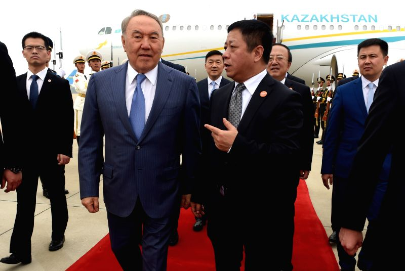 QINGDAO, June 9, 2018 - Kazakh President Nursultan Nazarbayev (L, front) arrives in Qingdao, east China's Shandong Province, June 9, 2018. Nazarbayev is on a state visit to China and will attend the ...