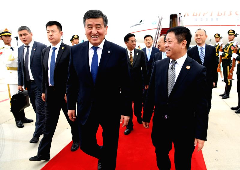 QINGDAO, June 9, 2018 - Kyrgyz President Sooronbay Jeenbekov (2nd R, front) arrives in Qingdao, east China's Shandong Province, June 9, 2018. Jeenbekov is on a state visit to China and will attend ...