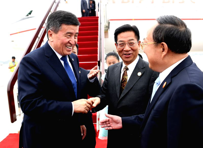 QINGDAO, June 9, 2018 - Kyrgyz President Sooronbay Jeenbekov (1st L) is greeted upon his arrival in Qingdao, east China's Shandong Province, June 9, 2018. Jeenbekov is on a state visit to China and ...