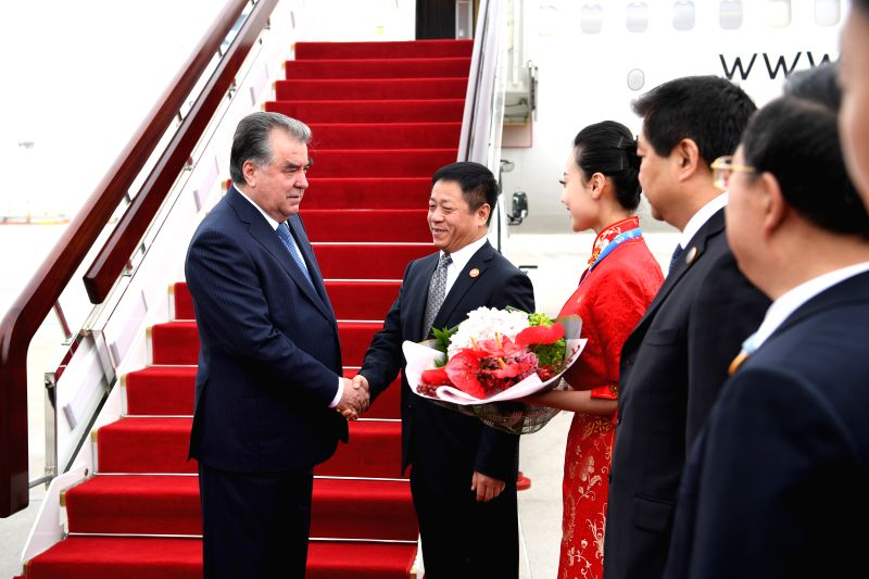 QINGDAO, June 9, 2018 - Tajik President Emomali Rahmon (1st L) is greeted upon his arrival in Qingdao, east China's Shandong Province, June 9, 2018. Rahmon is here to attend the 18th Shanghai ...