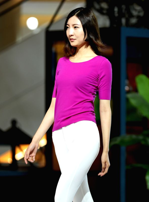 """QINGDAO, May 12, 2016 - A model presents Sang Sha collections at """"vogue Zhucheng"""" fashion show during the 16th China (Qingdao) International Fashion Week in Qingdao, east China's Shandong ..."""