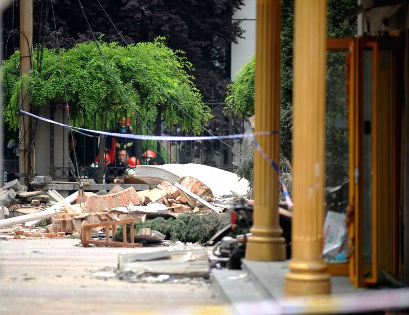 Debris are seen at a gas explosion site in Qingdao, east China's Shandong Province, May 19, 2015. At least two people were confirmed dead and over 10 others were ...