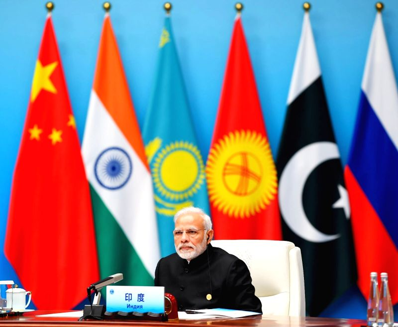 : Qingdao: Prime Minister Narendra Modi attends the Restricted Session of the Shanghai Cooperation Organisation (SCO) Summit in Qingdao, China on June 10, 2018. (Photo: IANS/PIB).
