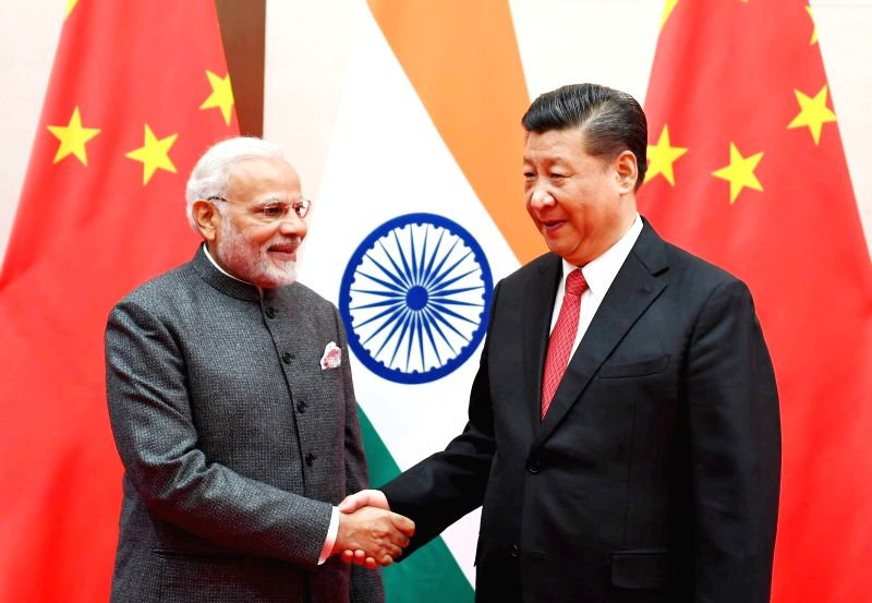:Qingdao: Prime Minister Narendra Modi meets Chinese President Xi Jinping, on the sidelines of the Shanghai Cooperation Organisation (SCO) Summit in Qingdao, China on June 9, 2018. (Photo: ...