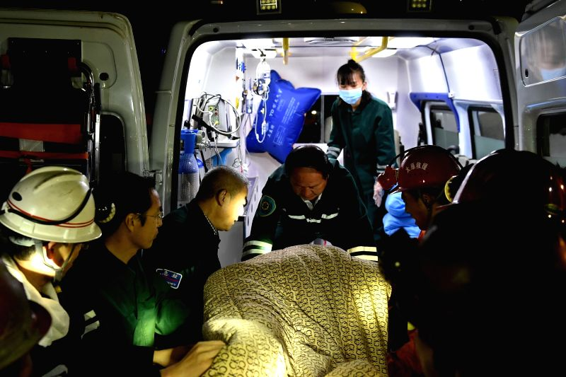 QINGXU, May 24, 2017 - Rescuers carry an injured miner on the ambulance at the site of Dongyu Coal Mine in Qingxu County near Taiyuan, north China's Shanxi Province, May 24, 2017. Six miners died and ...