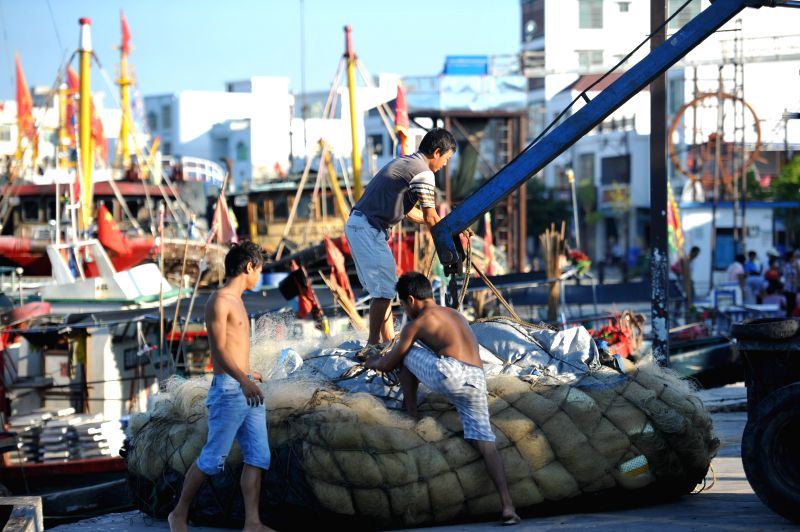 Fisherfolks prepare for fishing at the port of Qionghai, south China's Hainan Province. The annual fishing moratorium in Hainan, which lasts from May 16 to Aug. 1 ...