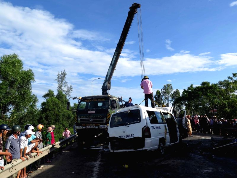 QUANG NAM, July 30, 2018 - Photo taken on July 30 shows the car crash site in Vietnam's central Quang Nam province. A coach carrying a bridegroom and his relatives and friends made a head-on ...