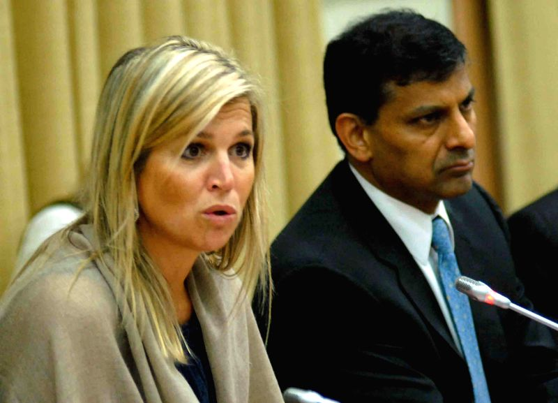 Queen Maxima of the Netherlands with Reserve Bank of India (RBI) Governor Dr. Raghuram Rajan and RBI Deputy Governor H R Khan during a press conference at RBI Headquarters in Mumbai on July 2, 2014. - H R Khan