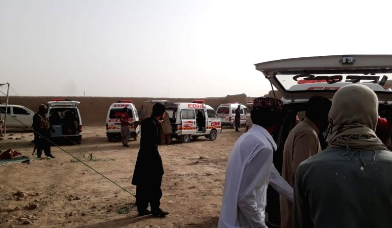 QUETTA,Ambulances park near the blast site in southwest Pakistan's Mastung on July 13, 2018. At least 30 people were killed and 60 others injured after a suicide ...