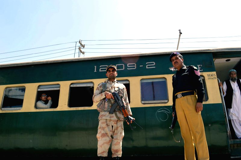 Security officers stand guard outside a passenger train at a railway station in southwest Pakistan's Quetta on April 10, 2014. Banned militant outfit United Baloch .