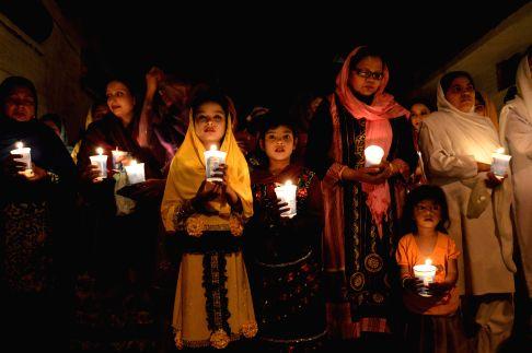 A Pakistani Christian attends midnight Easter mass in southwest Pakistan's Quetta, April 20, 2014.
