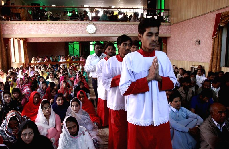 Pakistani Christians attend a Good Friday service at a church in southwest Pakistan's Quetta, April 3, 2015. Christian believers around the world mark the Holy Week ...