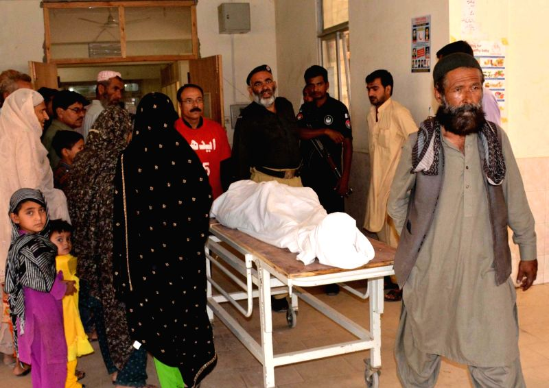 QUETTA, Aug. 1, 2016 - Rescuers transfer the body of a victim to a hospital in southwestern Pakistan's Quetta on Aug. 1, 2016. At least two Shiite Muslims were killed as gunmen opened fire on an ...