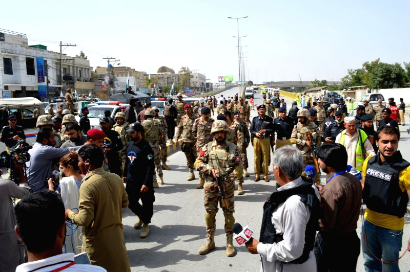 QUETTA, Aug. 11, 2016 - Pakistani soldiers and journalists gather at the blast site in southwest Pakistan's Quetta, Aug. 11, 2016. At least 12 people including four security personnel were injured in ...