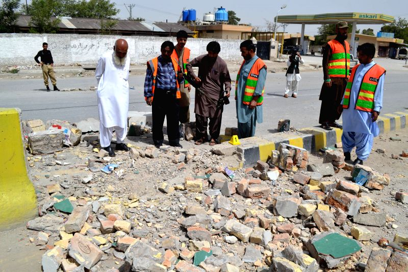 QUETTA, Aug. 11, 2016 - Security officials collect evidence at the blast site in southwest Pakistan's Quetta, Aug. 11, 2016. At least 12 people including four security personnel were injured in a ...