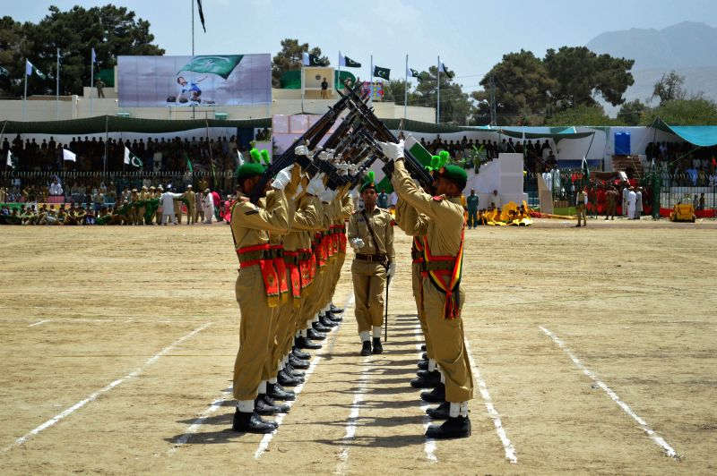 Pakistani cadets perform during a ceremony on the eve of Pakistan's 68th Independence Day in southwest Pakistan's Quetta on Aug. 13, 2014.  ...