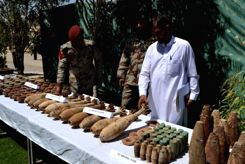 Pakistani officials display seized mortar shells to media in southwest Pakistan's Quetta, Aug. 20, 2014. Pakistani security forces showcased huge amount of weapons ..