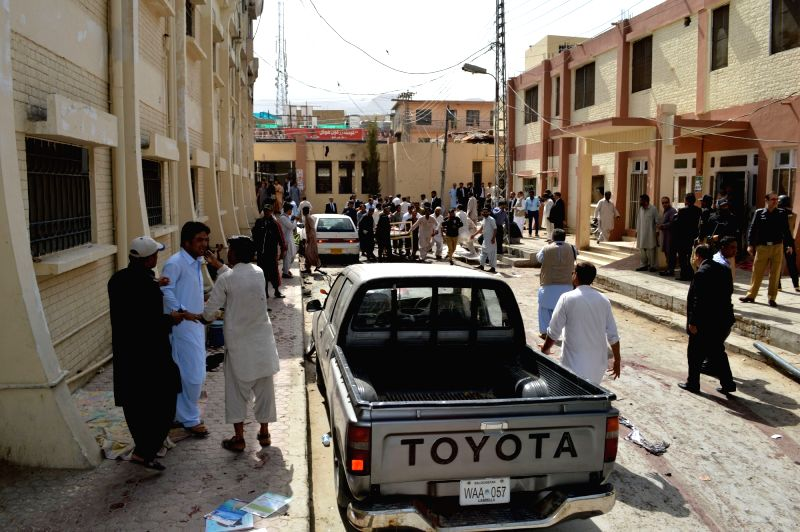 QUETTA, Aug. 8, 2016 - People gather around bodies of victims at the blast site in Quetta, southwest Pakistan, Aug. 8, 2016. At least 30 people were killed and 50 others injured when a blast hit a ...