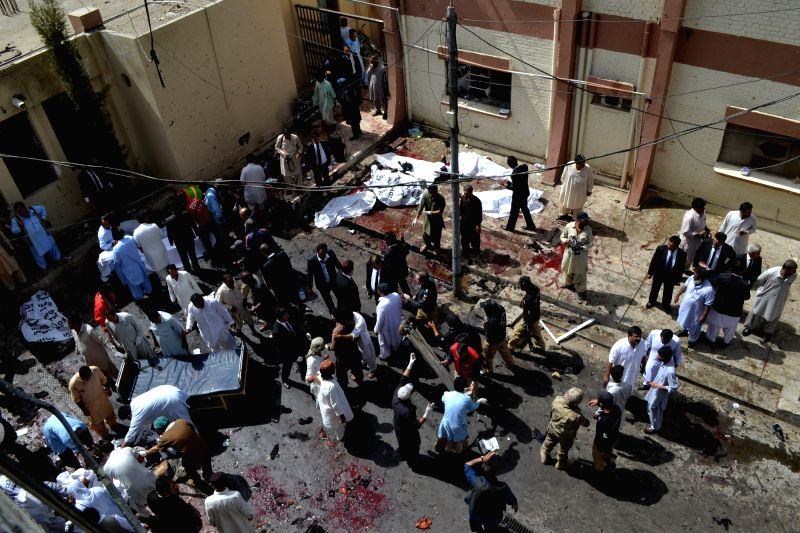 QUETTA, Aug. 8, 2016 - People gather at the blast site in Quetta, southwest Pakistan, Aug. 8, 2016. At least 53 people were killed and 56 others injured when a bomb went off inside the emergency ward ...
