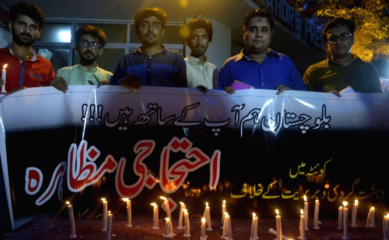 QUETTA, Aug. 8, 2016 - People light candles during a vigil to condemn the deadly hospital bomb blast in Quetta, in eastern Pakistan's Lahore on Aug. 8, 2016. At least 70 people were killed and 112 ...