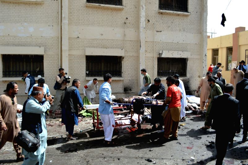 QUETTA, Aug. 8, 2016 - Rescuers remove bodies from the blast site in Quetta, southwest Pakistan, Aug. 8, 2016. At least 30 people were killed and 50 others injured when a blast hit a hospital in ...