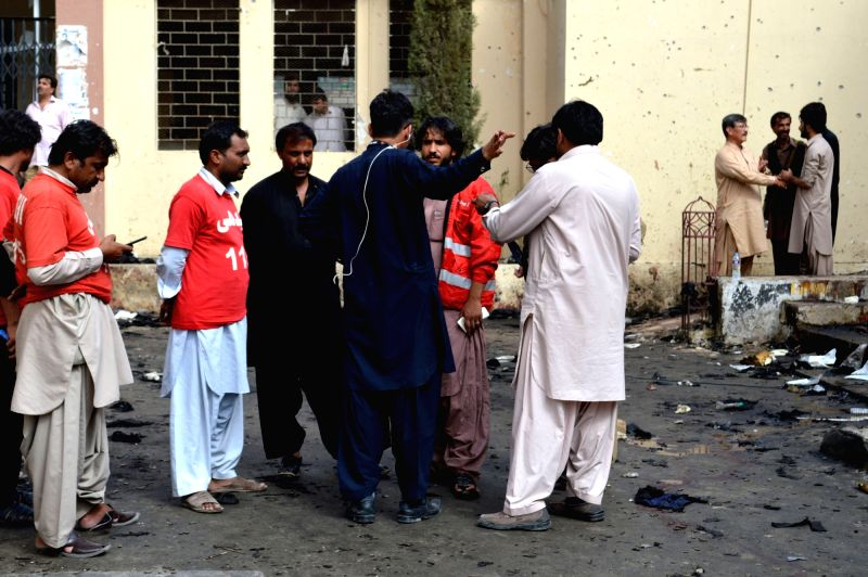 QUETTA, Aug. 9, 2016 - Rescuers gather at Civil Hospital the day after the deadly blast in southwest Pakistan's Quetta, Aug. 9, 2016. A splinter group of the Pakistani Taliban claimed responsibility ...