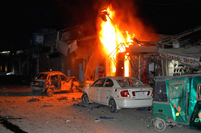 Fire rages at a blast site in southwest Pakistan's Quetta on Dec. 24, 2014.  At least four people were killed and 29 others wounded after a blast hit Pakistan's ...