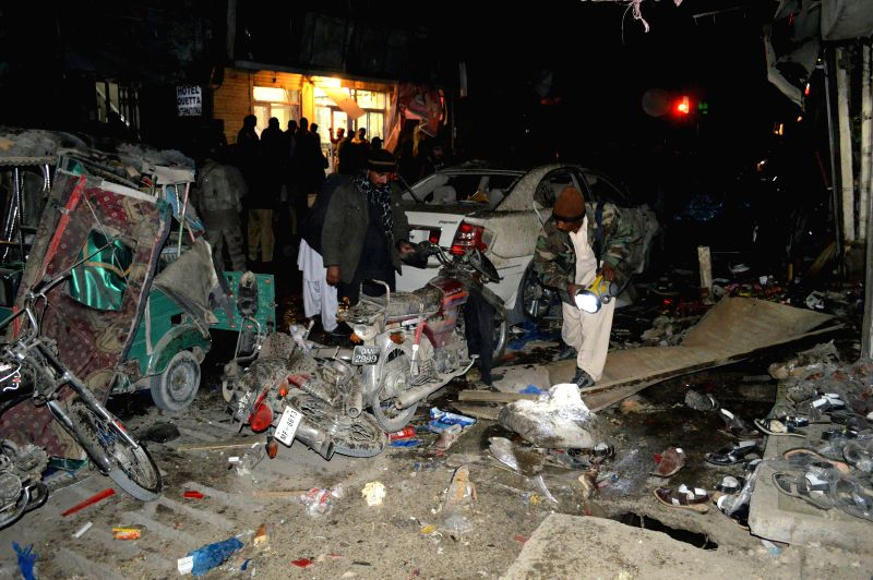 Security officials examine a blast site in southwest Pakistan's Quetta on Dec. 24, 2014. At least four people were killed and 29 others wounded after a blast hit ...