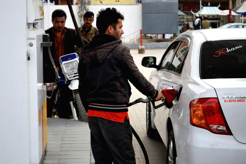 An employee fills the tank of a car at a fuel station in southwest Pakistan's Quetta on Feb. 1, 2015. Pakistan's Oil and Gas Regulatory Authority (OGRA) has reduced ..