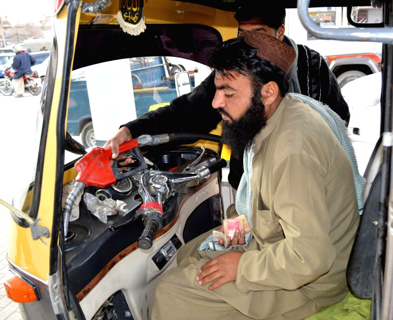 An employee fills the tank of an auto-rickshaw at a fuel station in southwest Pakistan's Quetta on Feb. 1, 2015. Pakistan's Oil and Gas Regulatory Authority (OGRA) ...