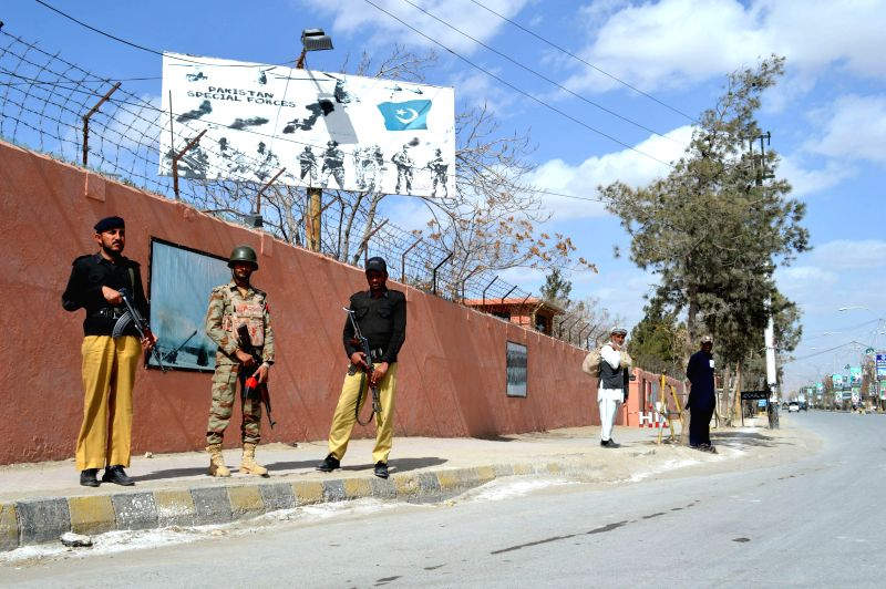 Pakistani policemen stand guard due to security high alert in southwest Pakistan's Quetta, Feb. 19, 2015. Pakistan is on security red alert after recent suicide ...