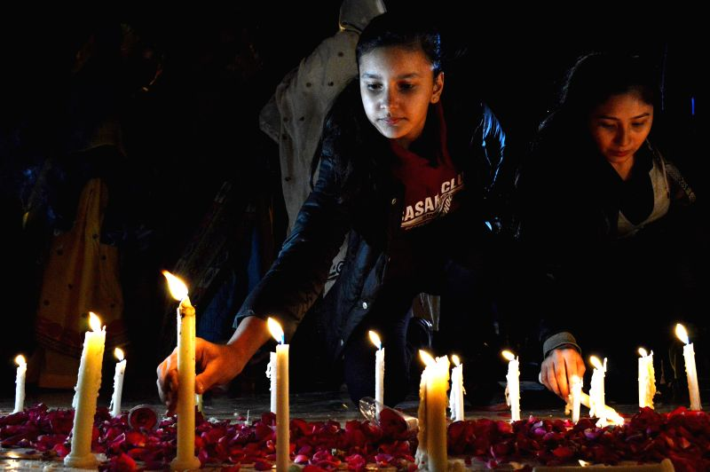 People light candles during a vigil ceremony for the victims of terrorism in southwest Pakistan's Quetta on Feb. 23, 2015.