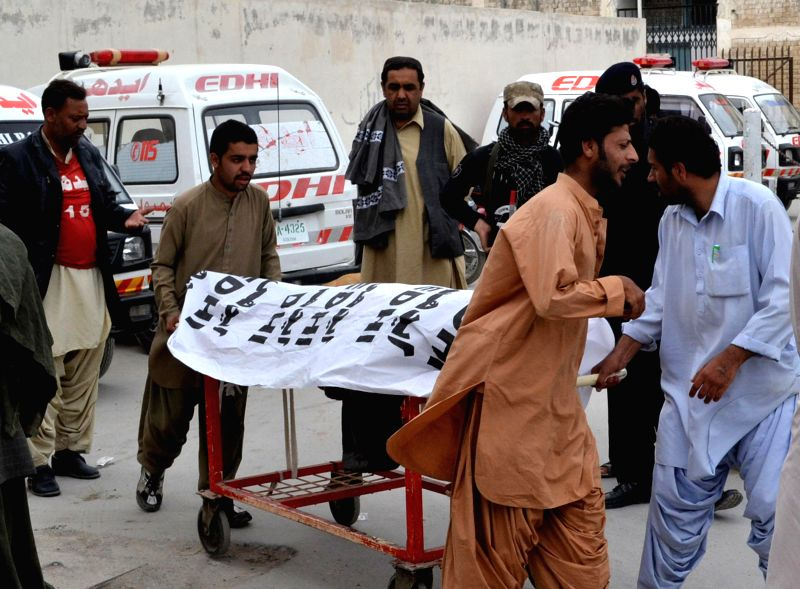 People transfer a body to a hospital in Quetta, southwest Pakistan, on Feb. 24, 2015. At least one person was killed and two others were injured in a gunmen attack ...