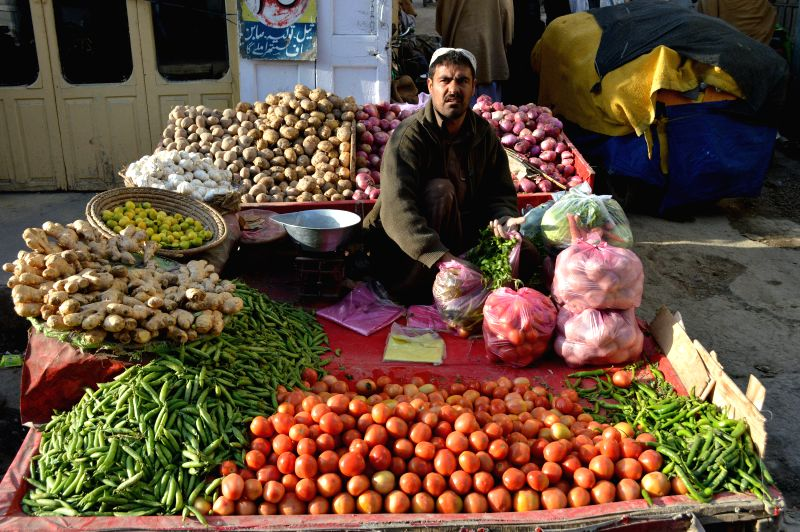 A vendor waits for customers at a local vegetable market in southwest Pakistan's Quetta on Jan. 31, 2015. The World Bank has projected 1.5 billion USD and the Asian .