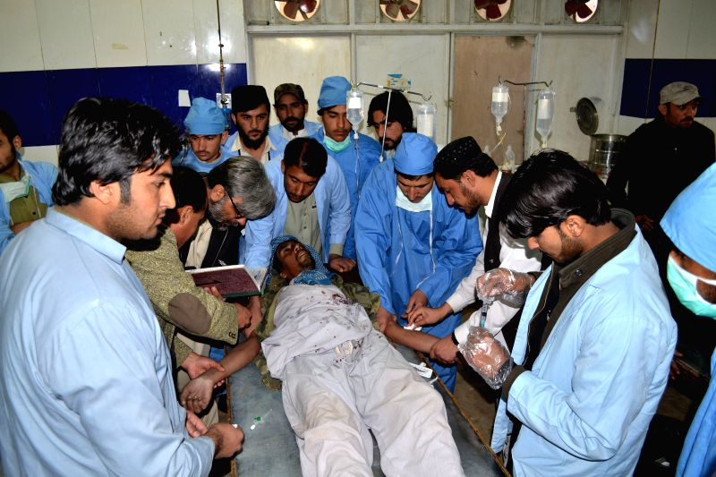 An injured man receives medical treatment at a hospital in southwest Pakistan's Quetta, Jan. 7, 2015. At least five laborers were killed and another injured as ...