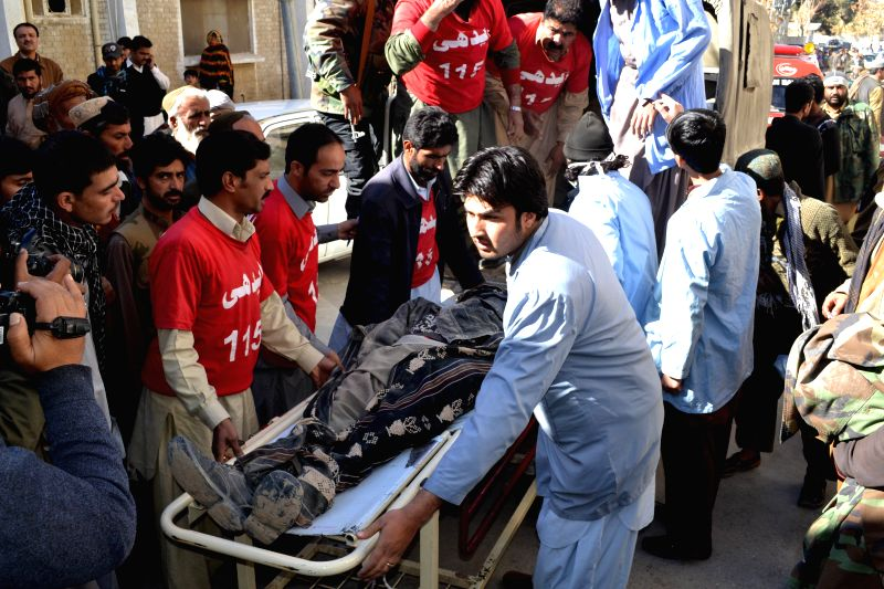 Pakistani rescuers transfer the body of a victim to a hospital in southwest Pakistan's Quetta, Jan. 7, 2015. At least five laborers were killed and another injured as