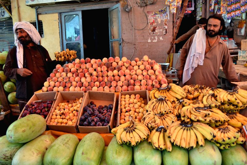 A vendor sells  fruits during holy month of Ramadan in southwest Pakistan's Quetta, July 18, 2014. Muslims around the world celebrate Ramadan in which they abstain ..
