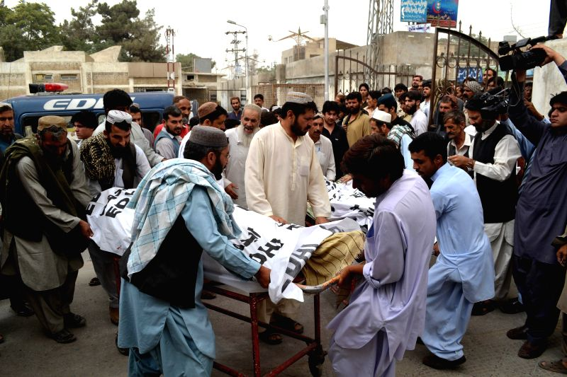 Rescuers transfer bodies to a hospital in southwest Pakistan's Quetta, July 18, 2014. At least four people have been killed in the firing outside a mosque in Quetta .
