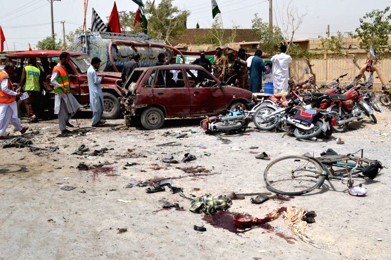QUETTA, July 25, 2018 - Security officials inspect the blast site in southwest Pakistan's Quetta, on July 25, 2018. At least 29 people, including three policemen, were killed and over 40 others ...
