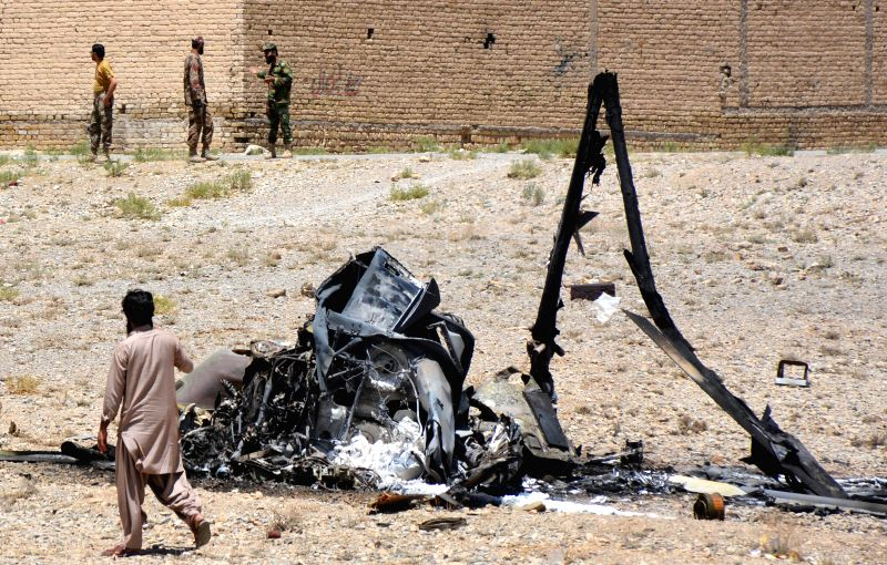 QUETTA, June 7, 2018 - A Pakistani security official stands beside the wreckage of an army helicopter after a crash on the outskirts of Quetta, southwest Pakistan, on June 7, 2018. Two crew members ...