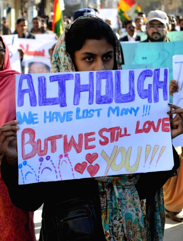 A Pakistani Muslim holds a placard during a protest against suicide bomb attacks on churches in Lahore which killed over 15 people in southwest Pakistan's Quetta on ...