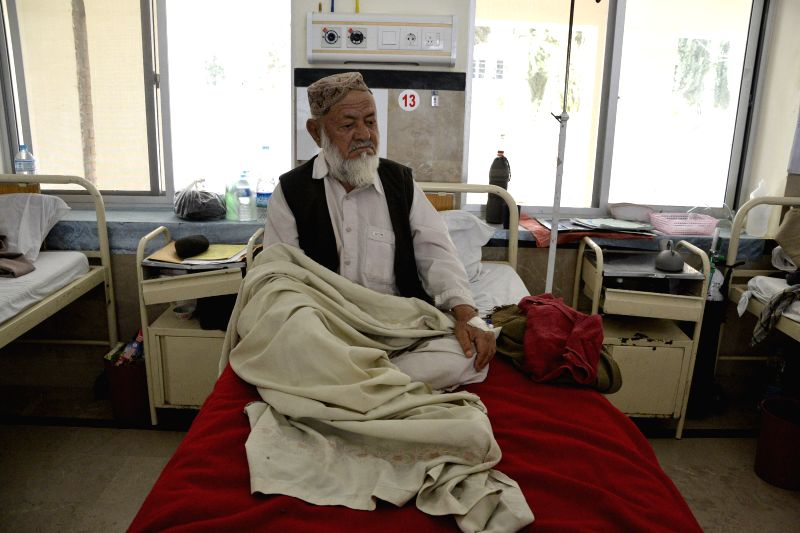 A tuberculosis patient receives medical treatment at a hospital on World Tuberculosis Day in southwest Pakistan's Quetta on March 24, 2015. The World Tuberculosis ...
