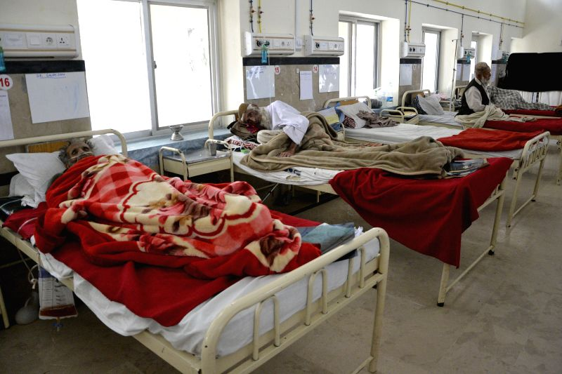 Tuberculosis patients receive medical treatment at a hospital on World Tuberculosis Day in southwest Pakistan's Quetta on March 24, 2015. The World Tuberculosis Day ...