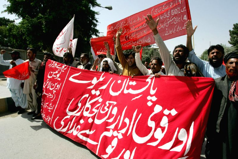 Workers from a Pakistani labor union shout slogans during a May Day rally to mark the International Labor Day in southwest Pakistan's Quetta on May 1, 2014. Hundreds ..