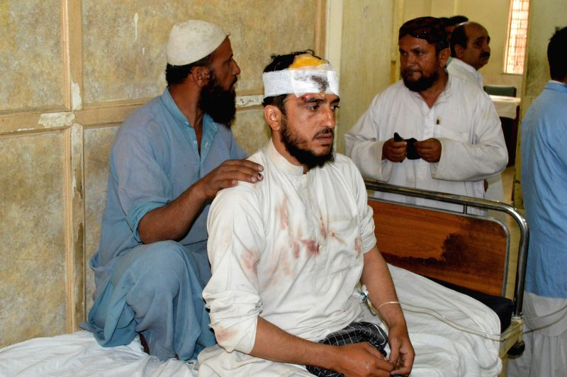 QUETTA, May 10, 2016 - An injured man receives medical treatment at a hospital in southwestern Pakistan's Quetta on May 10, 2016. At least 2 policemen were killed and 11 others injured when a blast ...