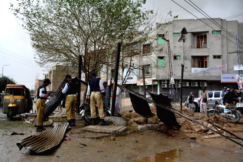 QUETTA, May 10, 2016 - Policemen inspect the explosion site in southwestern Pakistan's Quetta on May 10, 2016. At least 2 policemen were killed and 11 others injured when a blast hit a police check ...