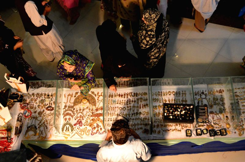 People visit a handmade jewellery exhibition in southwest Pakistan's Quetta on May 14, 2014. Handmade jewellery of Pakistan's Balochistan Province is very famous in ..