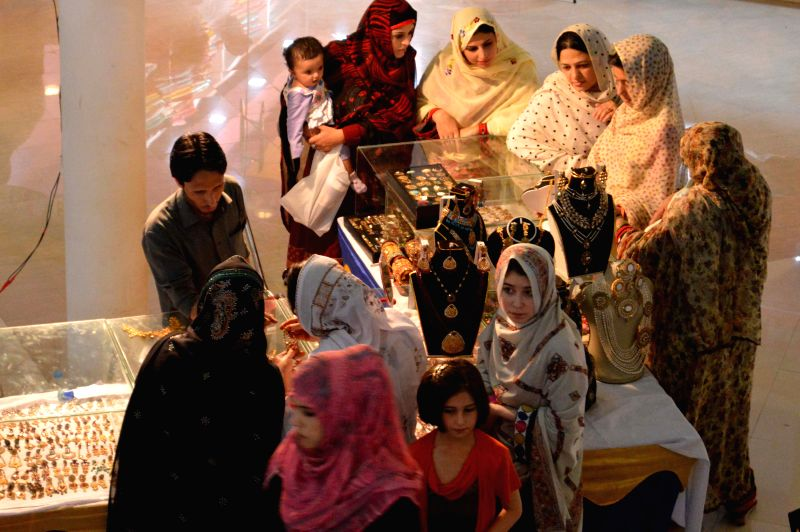 People visit a handmade jewellery exhibition in Quetta of Balochistan Province, southwest Pakistan on May 14, 2014. Handmade jewellery of Pakistan's Balochistan ...