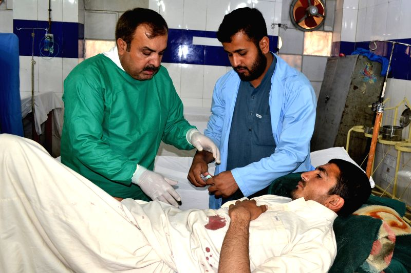 QUETTA, May 5, 2017 - Pakistani paramedics give treatment to an injured man at a hospital following cross-border firing, in southwest Pakistan's Quetta, on May 5, 2017. Pakistan army said on Friday ...